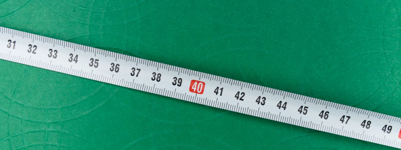 This is a picture of a measuring tape on a green background